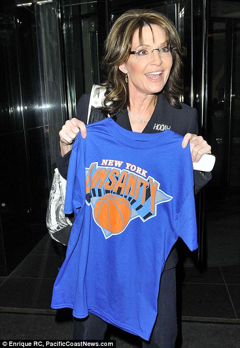 Showing her colors: Sarah Palin showed off her Linsanity t-shirt as she left her Manhattan hotel on Thursday, saying she was a big fan of the pointguard