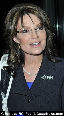 Supporting the troops: Palin's pin, which reads HOOAH, is in honor of American troops, for which the word is somewhat of a slogan
