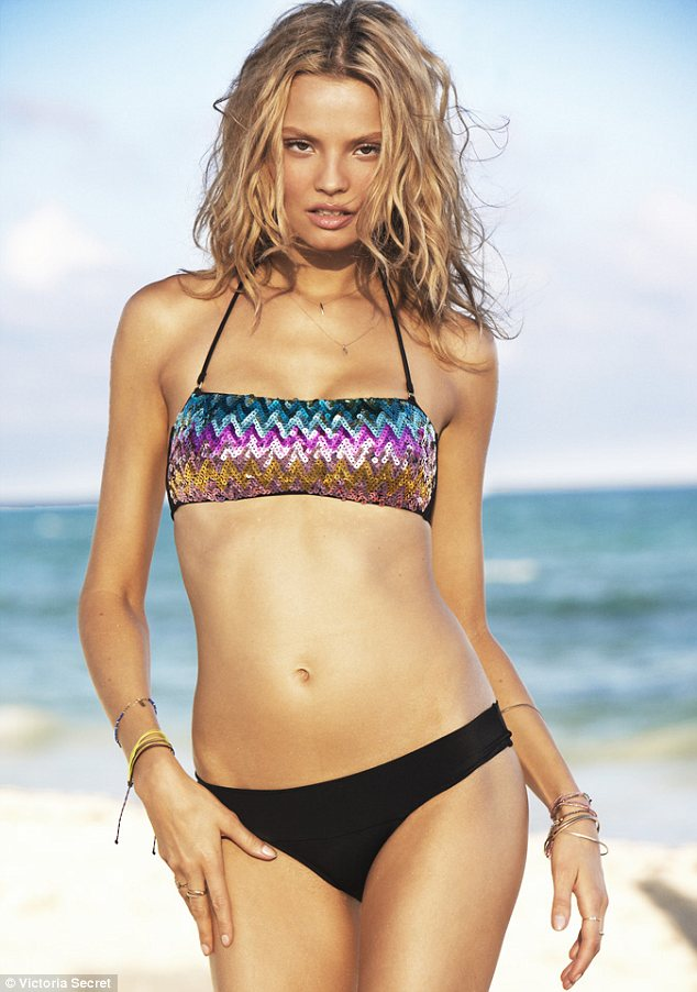 Ready for the disco: One bikini is the perfect party piece with a glittering sequin embellished top and plain black pants