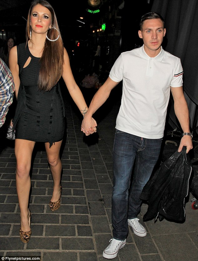 I wanna hold your hand: Natasha Giggs and Kirk Norcross seemed rather close as they left London nightclub Anaya Nightclub last night