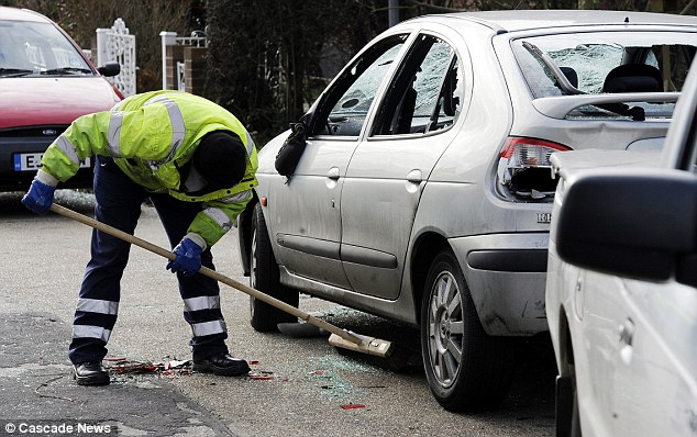 Basildon council clearing up after the attack, which caused serious damage to many vehicles