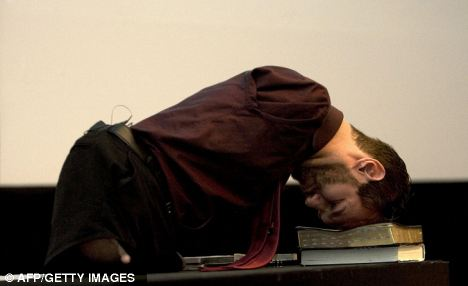 Head first: Vujicic demonstrates how he gets up without help during a motivational conference