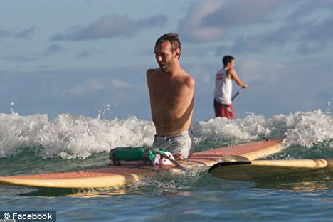 Brave man: Vujicic can do everything that an able bodied person can do, including surfing, writing and typing