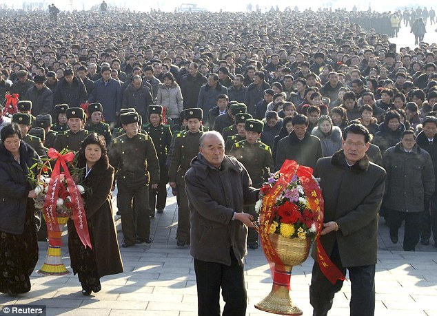 Outpouring: Huge numbers of North Koreans stood quietly to pay their respects