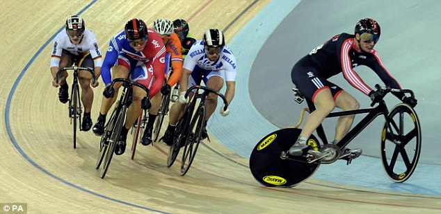 Man down: Team Sky's Matthew Crampton (right) crashes out of the keirin in round two
