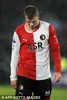 Feyenoord Rotterdam's Swedish striker John Guidetti leaves the field as he receives a red card