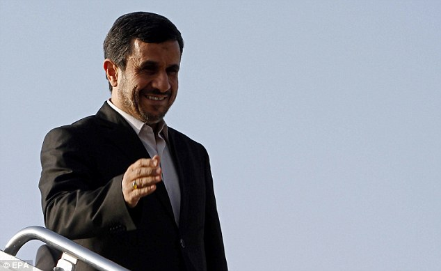 All smiles: Iranian President Mahmoud Ahmadinejad claimed earlier this week that the country had loaded its first domestically made fuel rod into a nuclear reactor