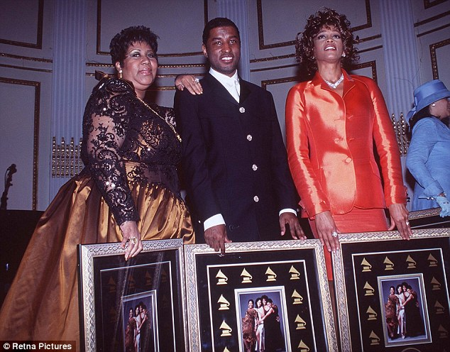 Close: Whitney and Aretha pictured together back in 1997 with singer-producer Babyface. A spokesman for the soul singer says she will grieve privately for Houston today