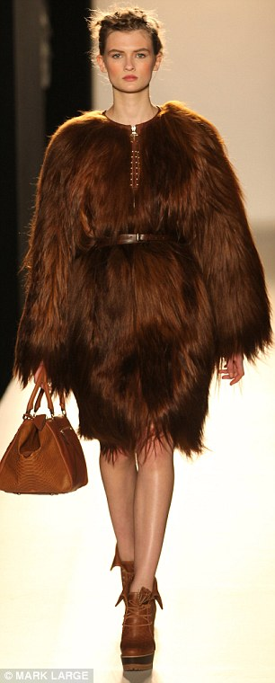 Furry chic: Yeti coats in brown and black were neatly cinched at the waist with narrow belts
