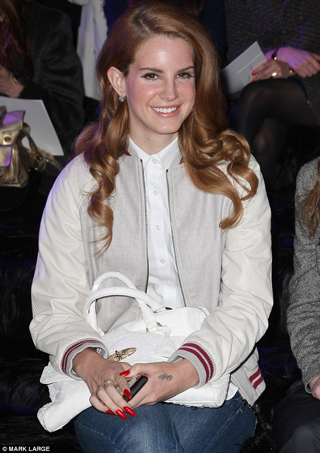 Star guest: Lana Del Rey held her bespoke Mulberry Del Rey bag in Ostrich White on her lap as she watched the catwalk in the Ballroom at Claridge's Hote