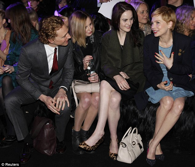 Comparing notes? Michelle Williams appeared to be offering some thoughts on the fashion to her fellow guests