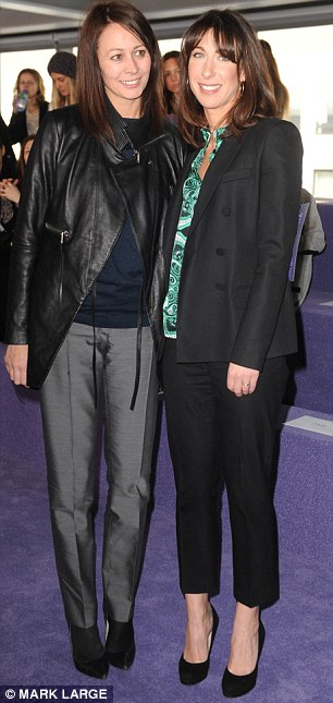 Sober: Samantha Cameron in Joseph trouser suit and Jonathan Saunders shirt, poses with BFC chief executive Caroline Rush at the Christopher Kane autumn/winter 2012 show today