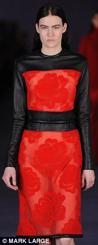Sheer red lace with floral motif was given edge with wet-look black trim