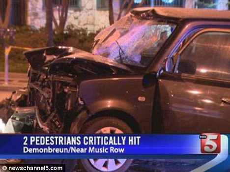 Wreckage: Trevor Bradshaw allegedly hit two people then drove the car across a central reservation in Nashville's Music Row area and hit a taxi