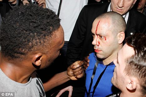 Bloodied: Haye's trainer Adam Booth was caught up in the melee