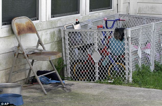 Only signs of life: The bikes in the backyard are the only sign that there were children inside, but they don't allude to the abuse they endured