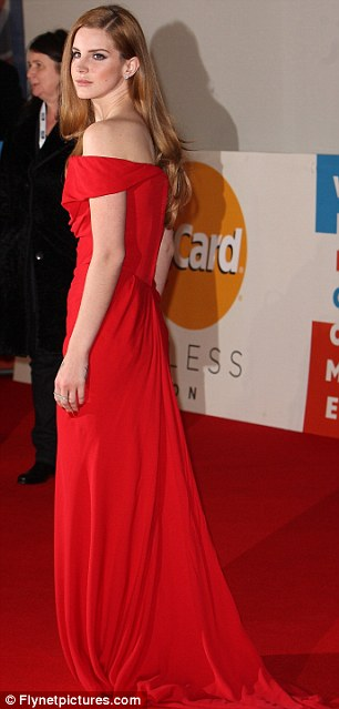 Red alert: Lana Del Rey looked stunning in an off-the-shoulder glamorous red number which nearly matched the red carpet