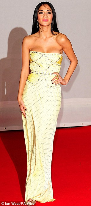 Mellow yellow: Nicole Scherzinger sported a low cut lemon yellow strapless gown with beaded detail