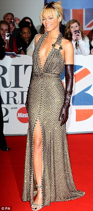 Good spirits: Rihanna smiled and waved as she posed for photographs on the carpet