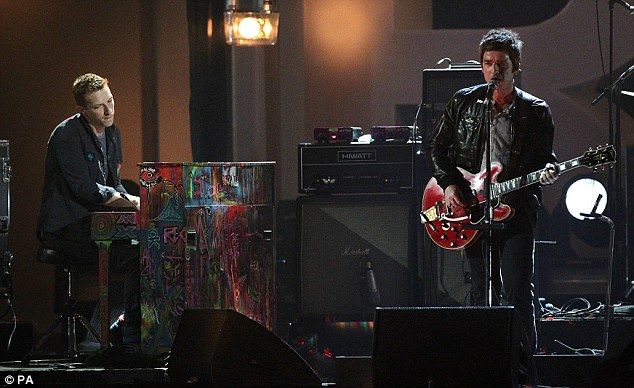 Special duo: Noel Gallagher was joined by Coldplay's Chris Martin as they performed for the stunned crowd