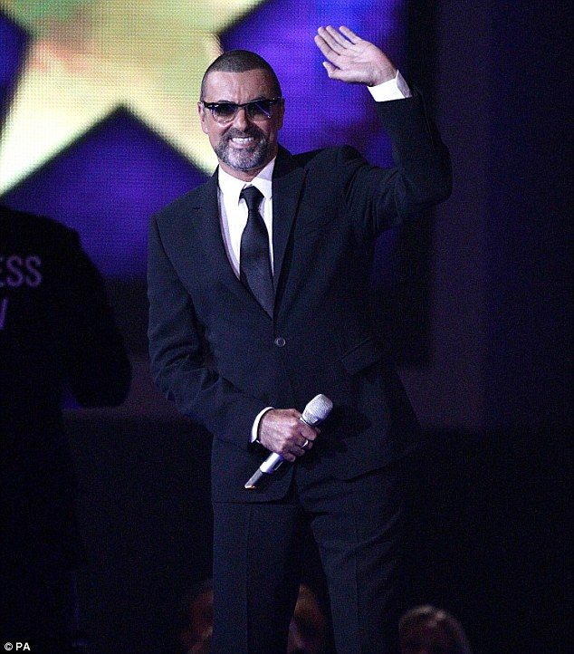 Back on form: George Michael made an appearance on stage at the glitzy bash, showing he's overcome his health scare