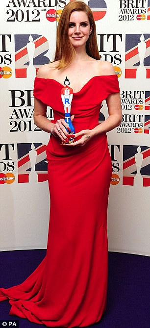 Proud winners: Lana poses with her International Breakthrough Award and Rihanna brandishes her Best International Female gong