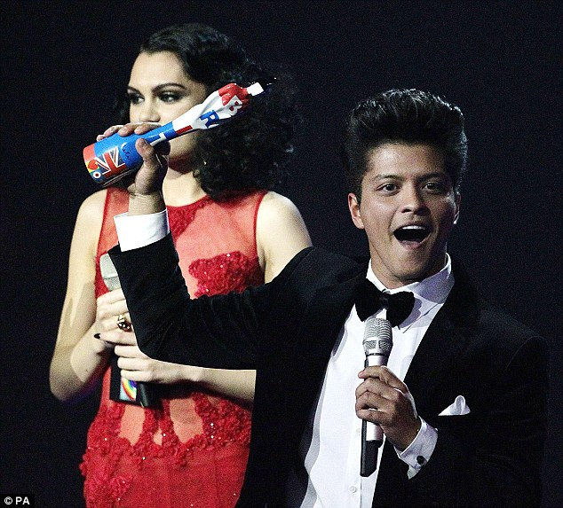Woo hoo! Bruno Mars collects the International Male Solo Artist award on stage, after being presented the gong by Jessie J