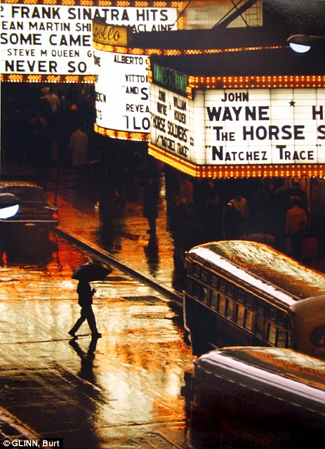 Bright lights: A pedestrian crosses 42nd Street in the rain in 1964, left, and a man wearing goggles tilts his head toward the camera on 14th Street, circa 1947-48, right
