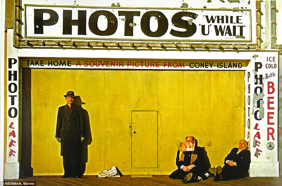 Souvenir: Men slumped over outside of a photobooth in Coney Island in this 1953 photo taken by Marvin Newman