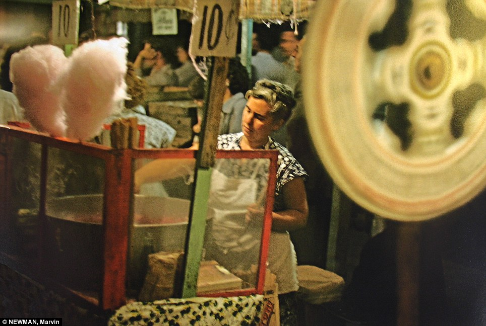 Spinning candy: A woman whirls up clouds of cotton candy at the San Gennaro Festival in Little Italy in 1952