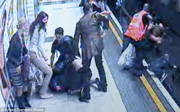 Samaritans: The woman is lifted off the Leicester Square train lines. She has a large gash on her side which witnesses initially believe is a stab wound