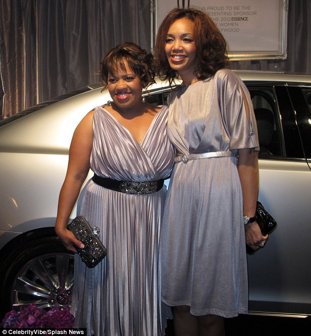 Strike a pose: Chandra Wilson and a pal were both draped in silver for the star-studded event
