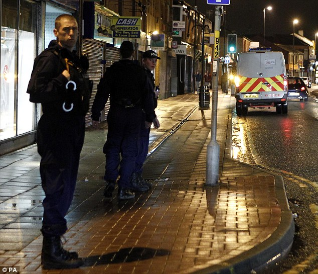 Prepared: Riot were brought in to help quell last night's disturbance