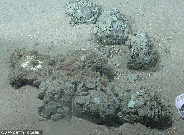 Trove: This picture shows hundreds of the silver coins recovered by Odyssey from the seabed off the coast of Portugal