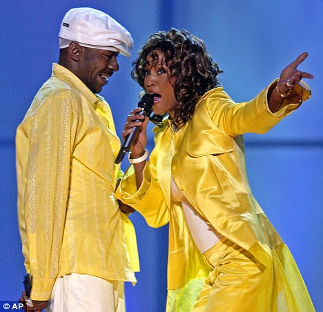 Marital music: Bobby Brown and Whitney perform together in back in 2003