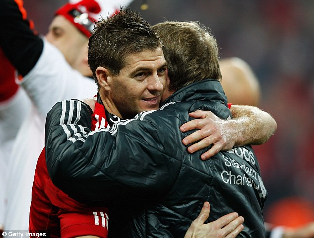 Hug it out: Steven Gerrard celebrates with his Liverpool manager Kenny Dalglish after their side's victory
