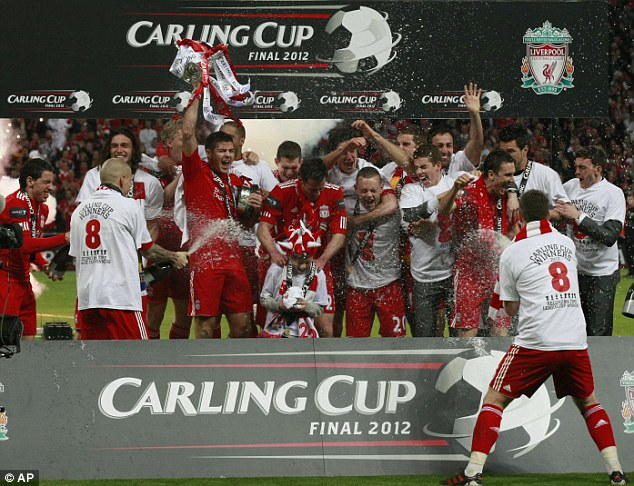 Party time! Liverpool celebrate their dramatic Carling Cup victory over Cardiff at Wembley