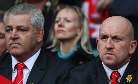 Eyeing a Slam: Gatland (left) watches on with defence coach Shaun Edwards