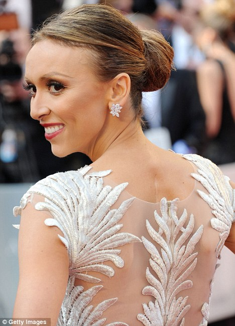 Tie in: The E! presenter's earrings matched her incredible gown
