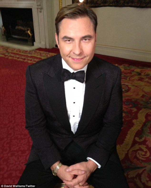 Looking dapper: The comedian later changed into this tuxedo for another part of the trailer