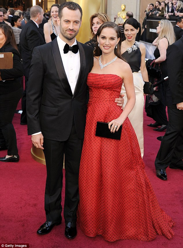 Gorgeous couple: The actress and fiance Benjamin Millipied pose on the red carpet