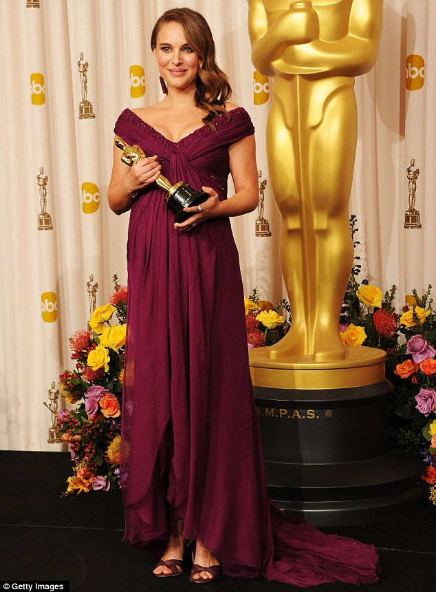 Golden girl: Then-pregnant Portman held her golden statue in 2011