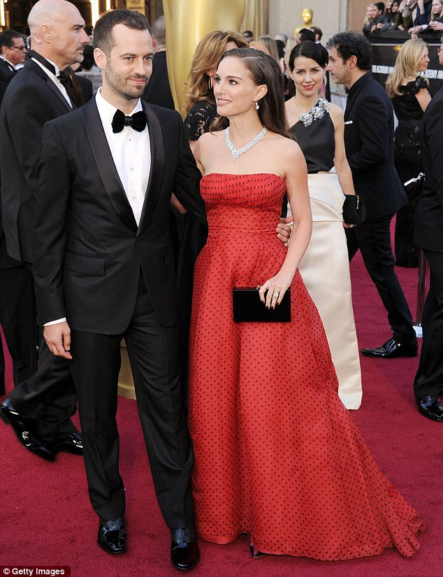 The look of love: The No Strings Attached star gazes adoringly at her fiance