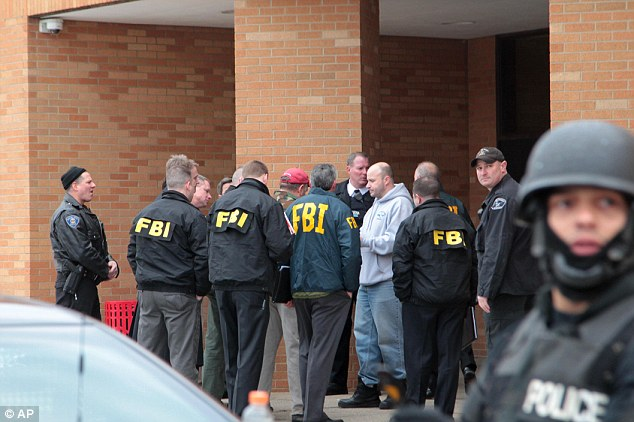 Keeping watch: FBI and police guarded the entrance of the high school