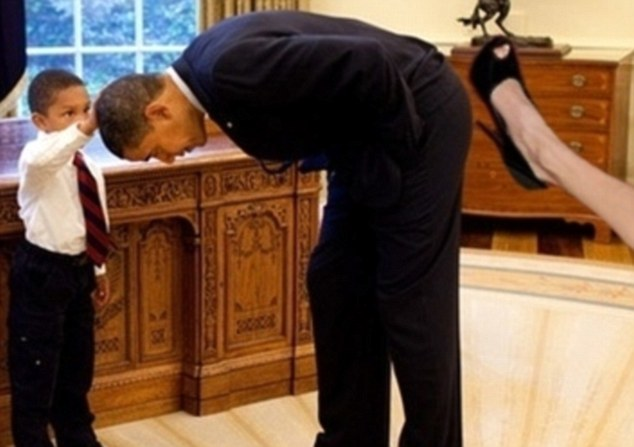 Legs akimbo: Perhaps Angelina Jolie might be slightly embarrassed to find out one of her pins is kicking President Barack Obama