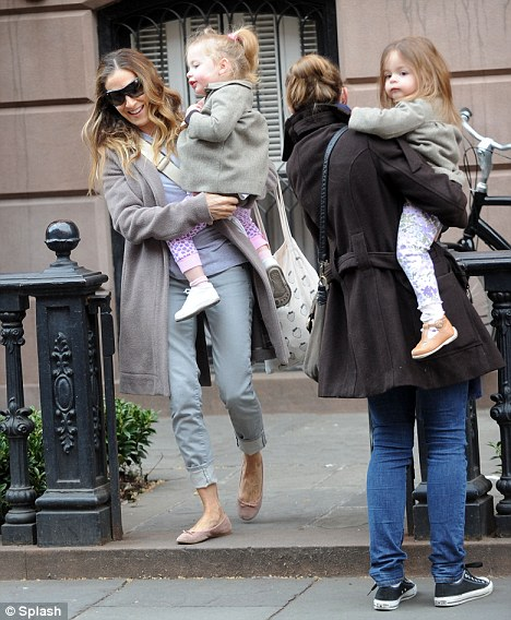 A little help: The 46-year-old actress had some help toting her tots
