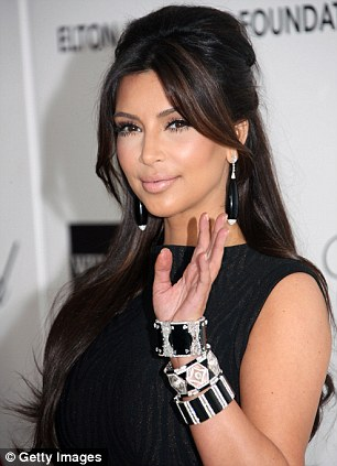 Contrast: Kim looked in sharp contrast to her usual flawless made-up look, but still looked picture perfect