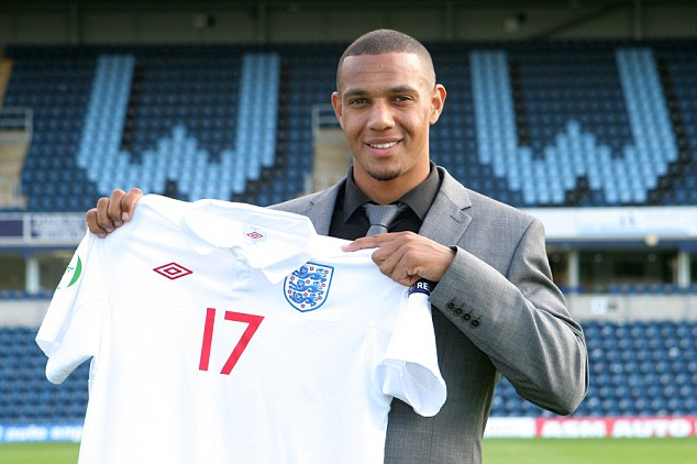 Proud day: Phillips poses with his England shirt after the Under 19 European Championships in 2010