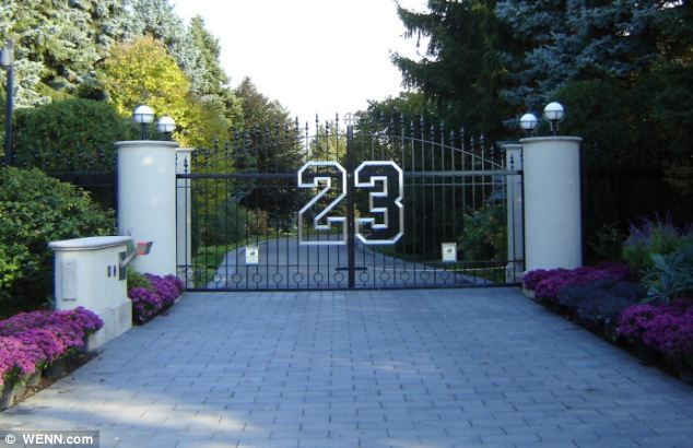 Basketball superstar: Michael Jordan's longtime home, gates emblazoned with the number 23 of his first Bulls jersey, has gone on the market
