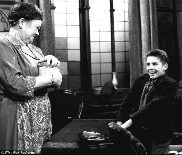 Davy Jones made an early appearance on the cobbles of Coronation Street in 1961. Here he is pictured playing Colin Lomax opposite Violet Carson as Ena Sharples